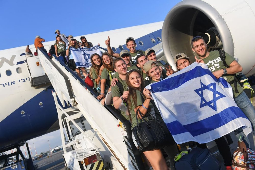 The American olim step foot in Israel and are now preparing to join the IDF. Credit: Shahar Azran.
