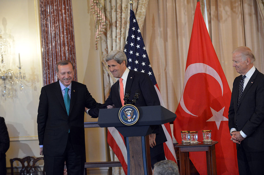Turkish President Recep Tayyip Erdogan (left) with U.S. Secretary of State John Kerry (center) and U.S. Vice President Joseph Biden (right) in 2013. Credit: Wikimedia Commons.