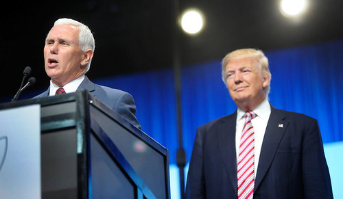 Republican vice presidential nominee Mike Pence with Republican running mate Donald Trump speaking at a VFW