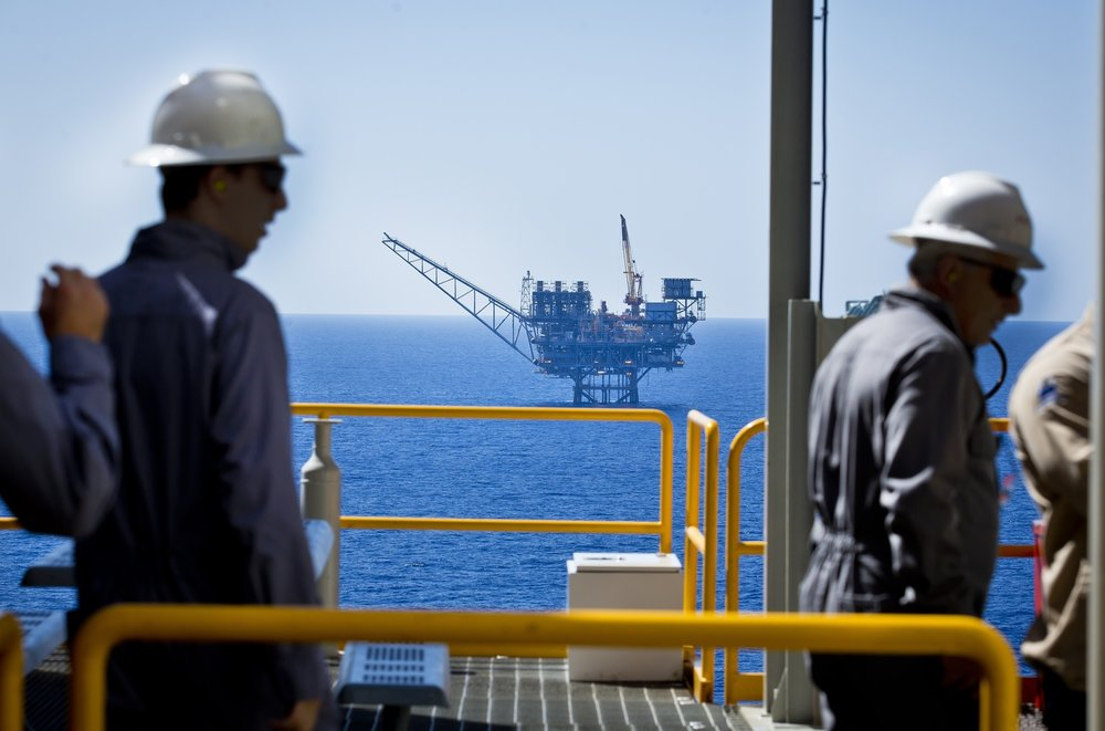 Workers seen at the Tamar gas field off the northern coast of Israel. Credit: Moshe Shai/Flash90.
