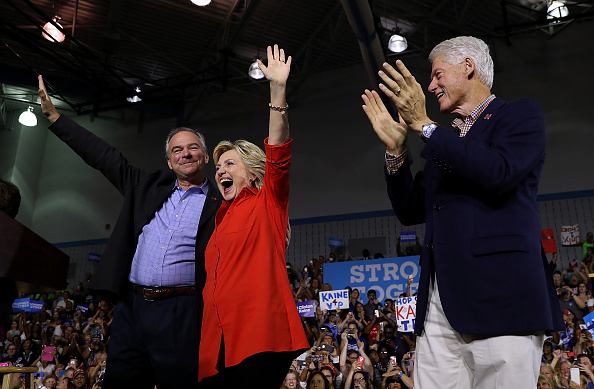 Dem. nominee Hillary Clinton and her Vice Presidential running mate Tim Kaine with former President Bill Clinton. Credit: Getty Images.