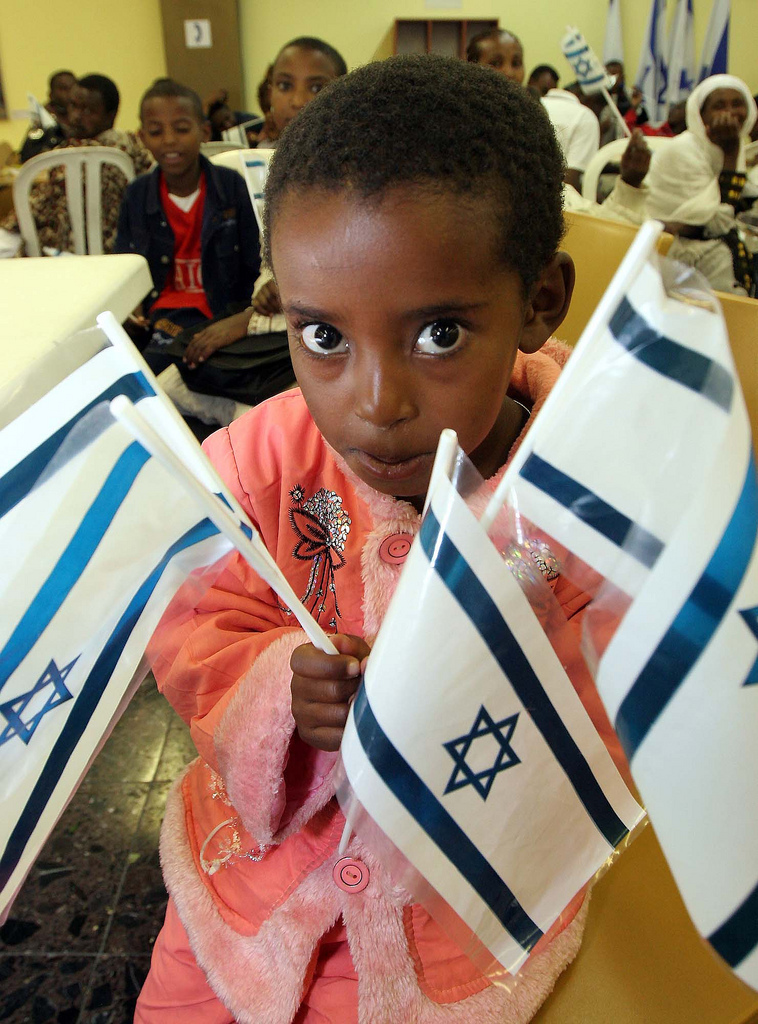 An Ethiopian Jewish child arriving in Israel in 2009. Credit: The Jewish Agency for Israel via Flickr.
