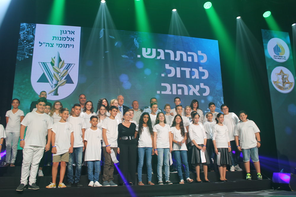 The participants in the IDF Widows and Orphans Organization's mass bar and bat mitzvah ceremony with Israeli leaders. Credit: Sam Sokol.