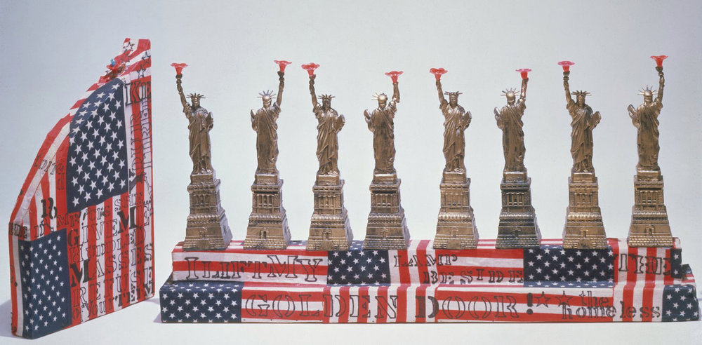 The Miss Liberty Hanukkah lamp was made with wood covered in fabric and plastic by Mae Rockland Tupa of Princeton, NJ, in 1974. Credit: The Jewish Museum.