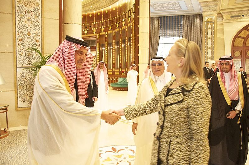 Former Secretary of State Hillary Clinton greeted by Saudi Prince Saud al-Faisal in Riyadh March 30, 2012. Credit: Wiki Commons.