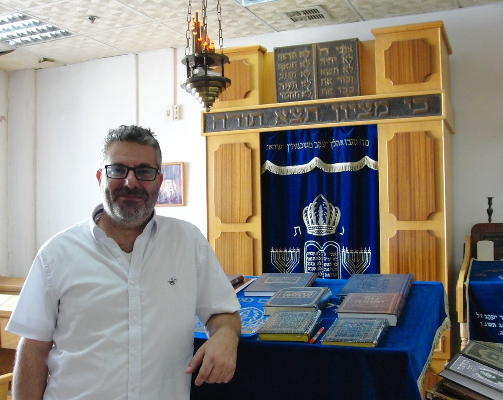 Ilan Ben Moshe, owner of Menorah Candle Company, in the small synagogue on the factory premises. Credit: Judy Lash Balint.