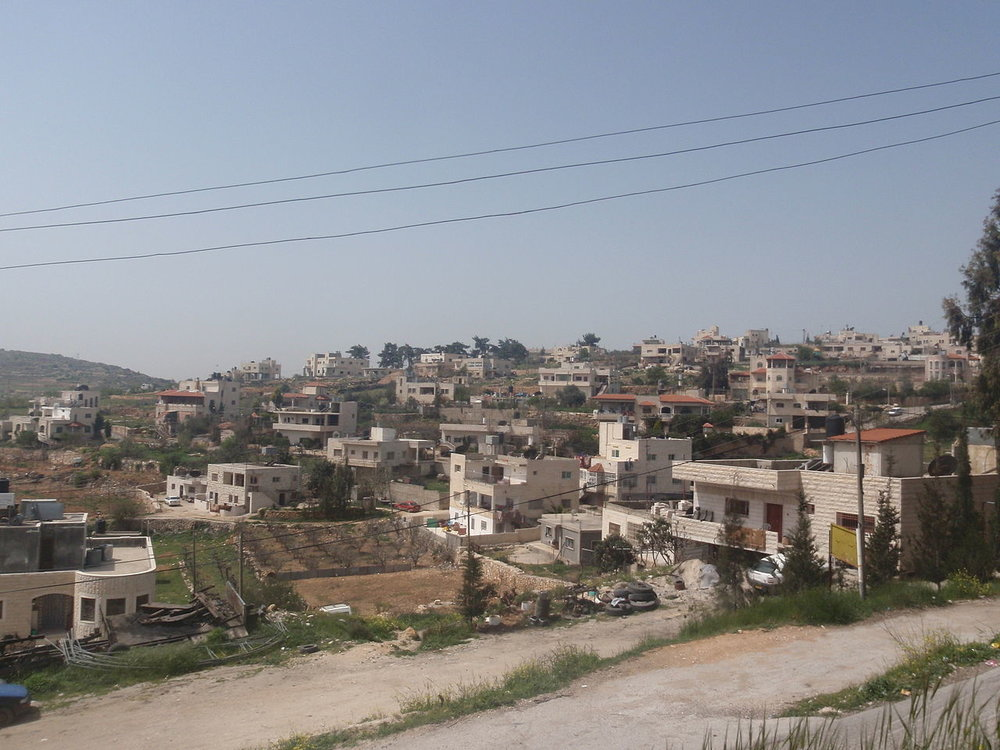 The Palestinian village of Beit Ummar near where three Israeli border police were attacked on Sunday. Credit: Wikimedia Commons.