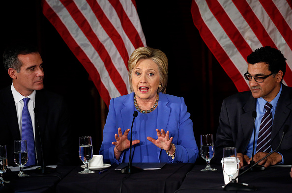 Hillary Clinton with the Muslim Public Affairs Council's Salam al-Marayati (right) and Los Angeles Mayor Eric Garcetti at a terrorism roundtable at the University of Southern California March 24.Credit: Getty Images.