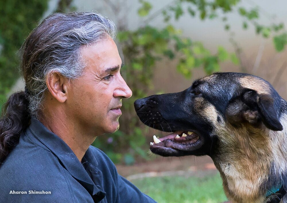 Uri Basha and his dog, Triton. Credit: Aharon Shimshon.