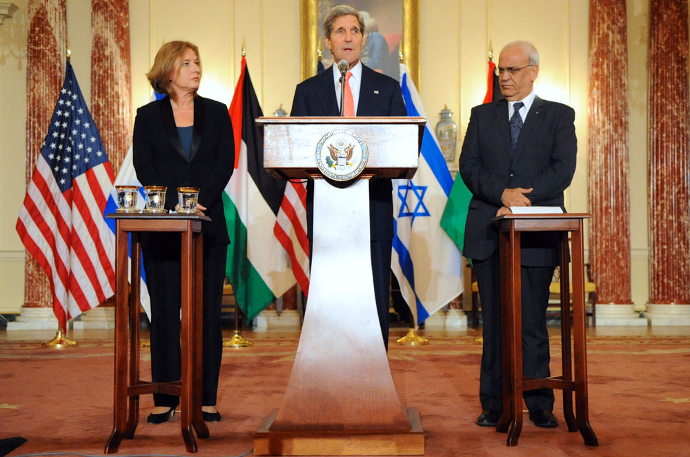 From left to right, Israeli Justice Minister Tzipi Livni, U.S. Secretary of State John Kerry, and Palestinian Chief Negotiator Saeb Erekat address reporters on Israeli-Palestinian peace talks in Washington, DC, on July 30, 2013. Israel on Monday told France that it will continue to oppose peace summits that do not directly involve the two parties to the Israeli-Palestinian conflict. Credit: State Department.