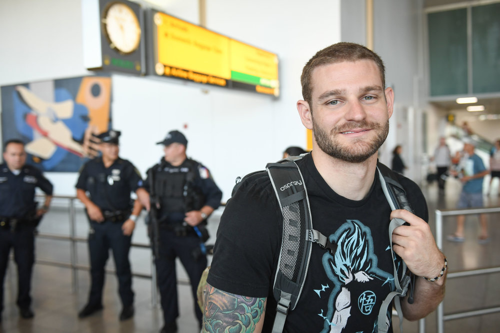 Steven Rich, a U.S. Marine who served in Afghanistan, is pictured at New York City's John F. Kennedy International Airport before making aliyah. Credit: Shahar Azran.