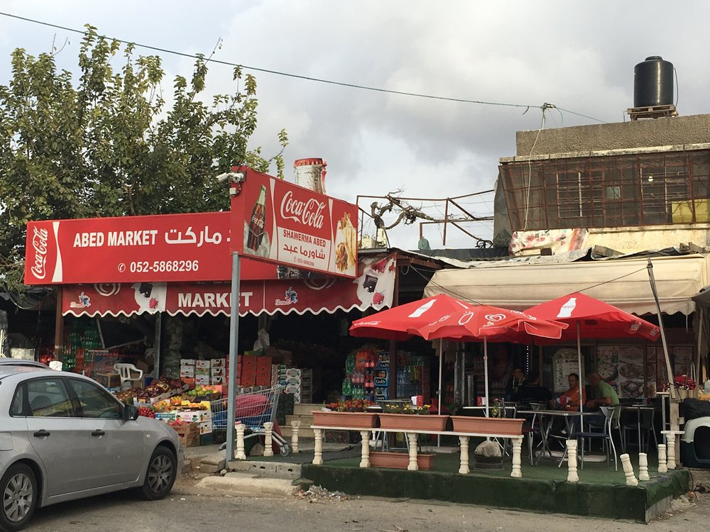 """Abed Market, a Palestinian-owned """"strip mall"""" where JNS.org interviewed Palestinian civilians about the U.S. election victory of Donald Trump. Credit: Orit Arfa."""