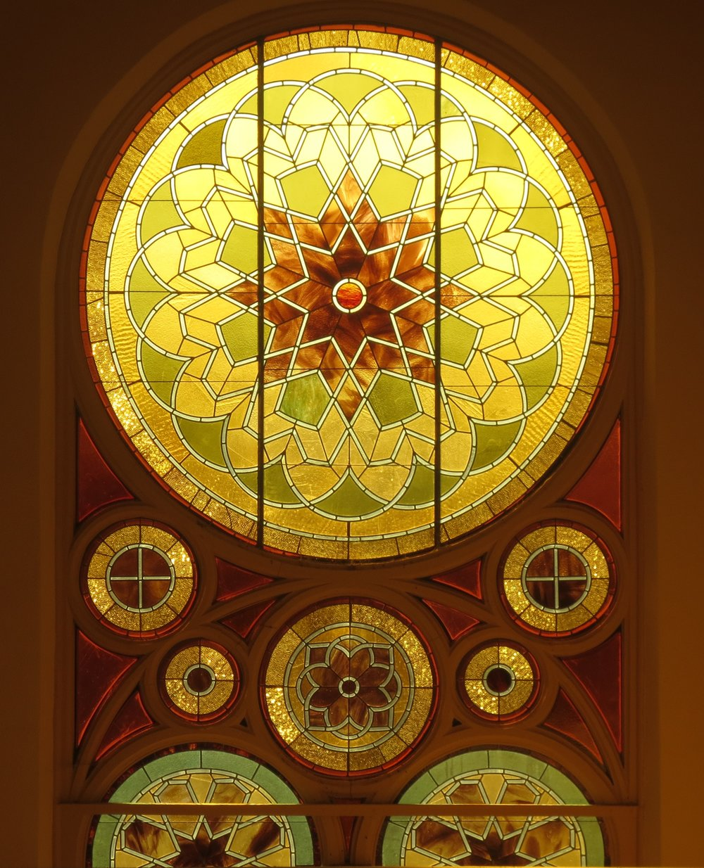 An original stained-glass window inside Congregation Ahavath Beth Israel of Boise. Credit: Dan Fellner.