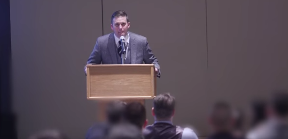 """Richard Spencer speaks at the National Policy Institute conference Nov. 19. He said, """"Hail Trump, hair our people, hail victory."""" Credit: YouTube screenshot via The Atlantic."""