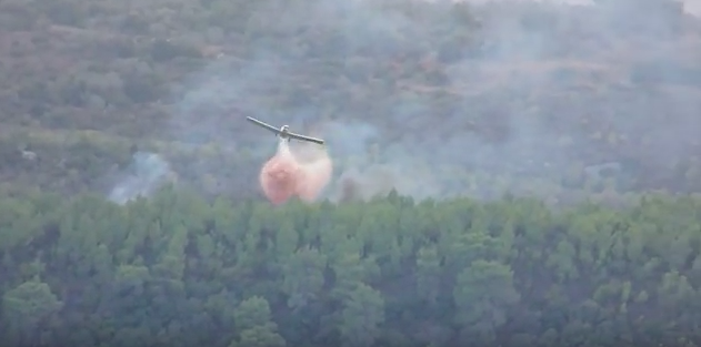 A plane helps put out a wildfire in Israel in 2010. Credit: YouTube screenshot.