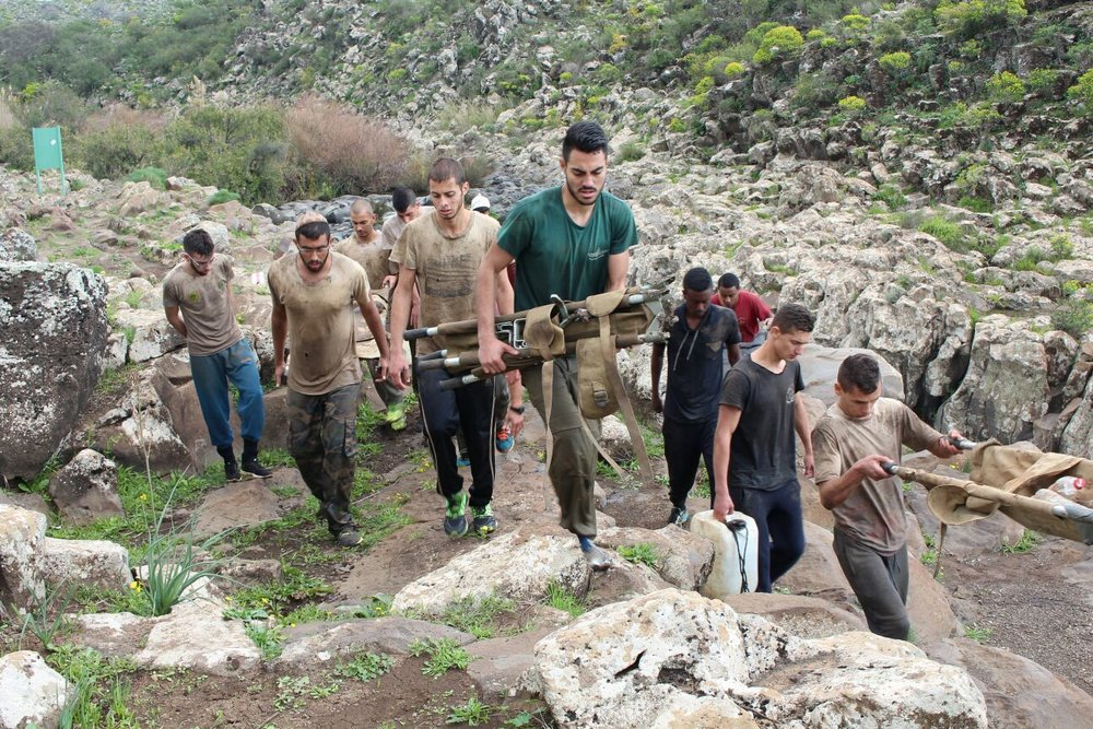 "A drill at the Tamir pre-military academy in northern Israel. Pictured in center (wearing green shirt) is Noam Ohayon, one of the few Tamir students who has passed the grueling four-day test known as ""Na'or Week."" Credit: Courtesy of Noam Ohayon."