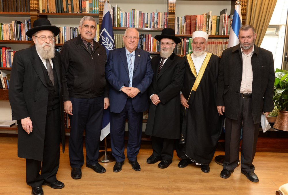 Israeli President Reuven Rivlin (third from left) poses Tuesday with Jewish and Muslim leaders at his residence in Jerusalem. Credit: Mark Neiman/GPO.