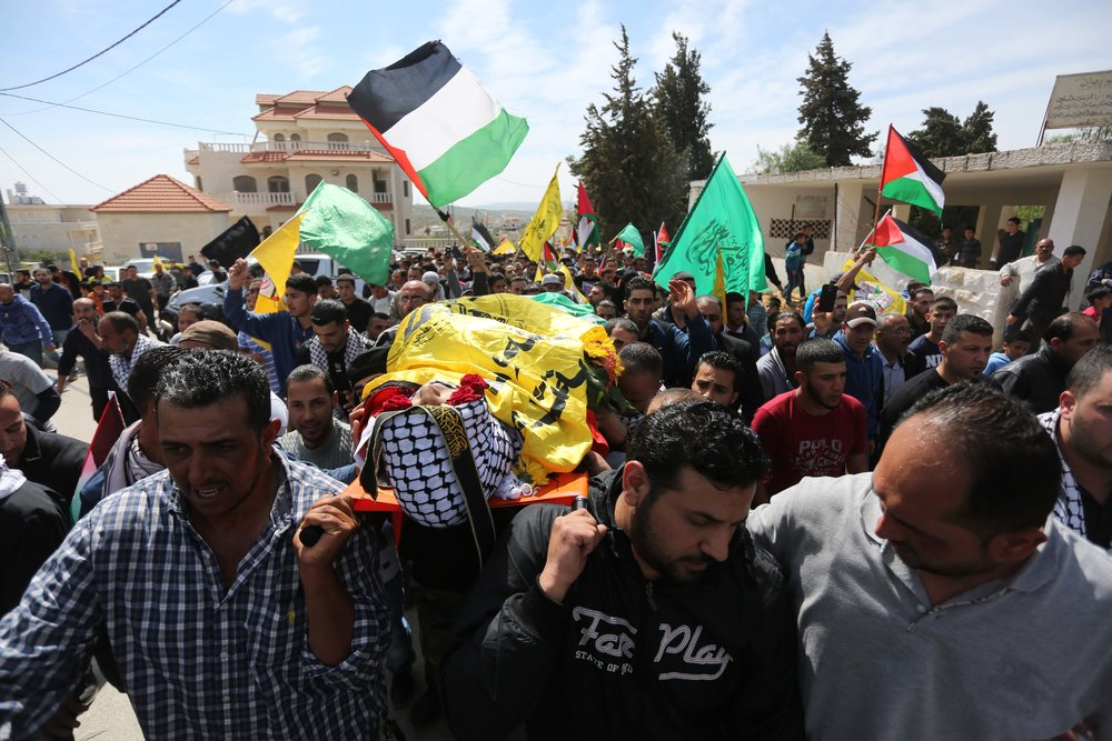 In March 2016 in the West Bank village of Deir Debwan, Palestinian mourners chant slogans while carrying the body of Mahmoud Shalan, a Palestinian-American terrorist who had tried to murder Israelis before security forces killed him. Credit: Flash90.