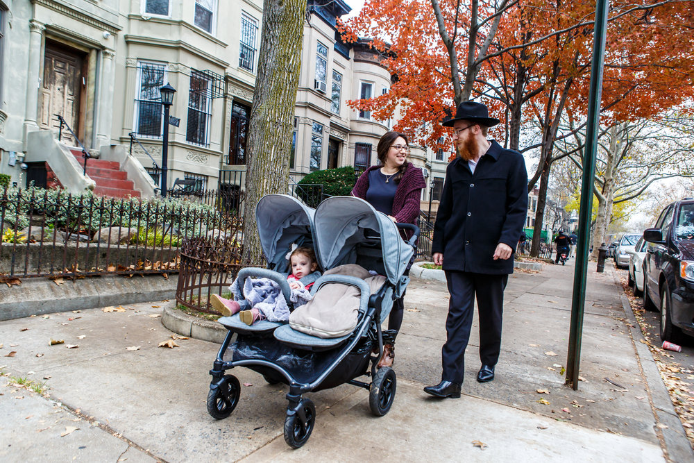 Rabbi Mendel Alperowitz and his wife Mussie, pictured here walking in Brooklyn, will soon settle in South Dakota as that state's first-ever Chabad emissaries. Credit: Chabad-Lubavitch.
