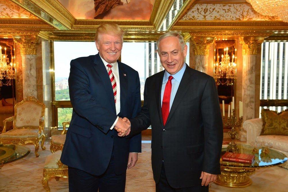 Donald Trump (left) shakes hands with Israeli Prime Minister Benjamin Netanyahu during their meeting at Trump Tower in New York City in September 2016. Credit: Kobi Gideon/GPO.