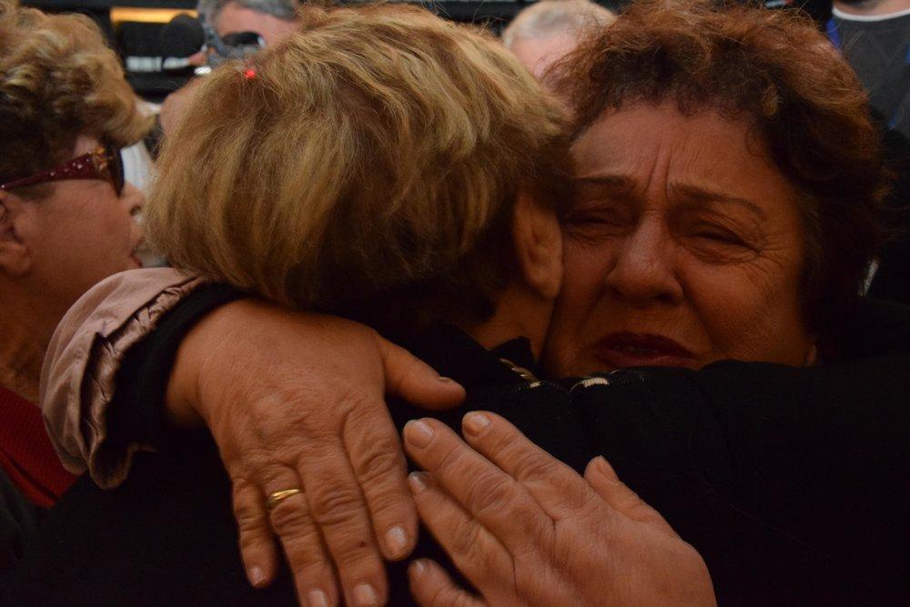 Holocaust-separated relatives Ryvka Borenstein Patchnik (left) and Fania Bilkay embrace for the first time at Yad Vashem in Jerusalem Dec. 13. Credit: Yad Vashem/Karina Pasternak.
