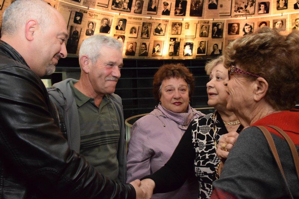 The Band and Borenstein families unite at Yad Vashem's Hall of Names in Jerusalem Dec. 13. Credit: Yad Vashem/Karina Pasternak.