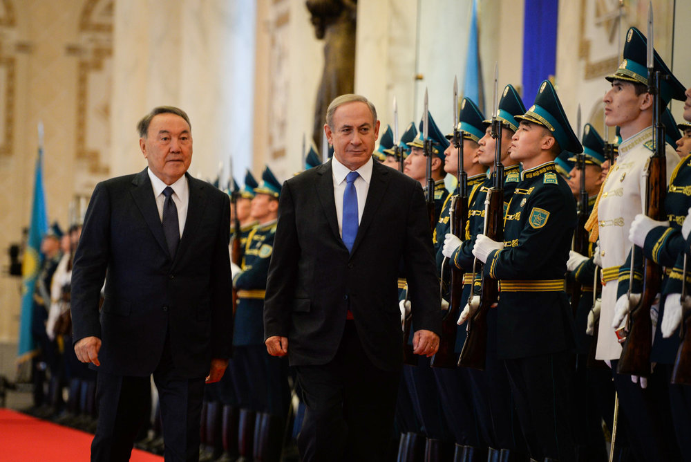 Israeli Prime Minister Benjamin Netanyahu (center) and Kazakh President Nursultan Nazarbayev (left) are welcomed at Kazakhstan's President's Palace Dec. 14, 2016. Credit: Haim Zach/GPO.