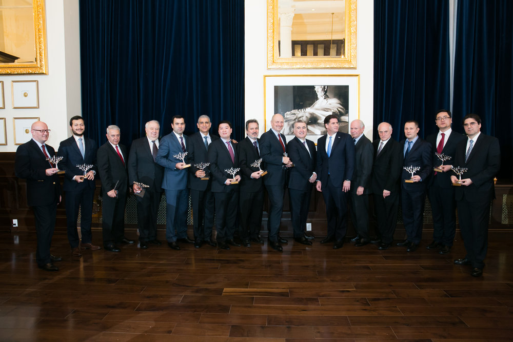 Dignitaries receive Hanukkah menorahs and pose for a group photo at the Dec. 14 Hanukkah party hosted by the Conference of Presidents of Major American Jewish Organizations and the Embassy of Azerbaijan in Washington, D.C. Credit: Conference of Presidents.