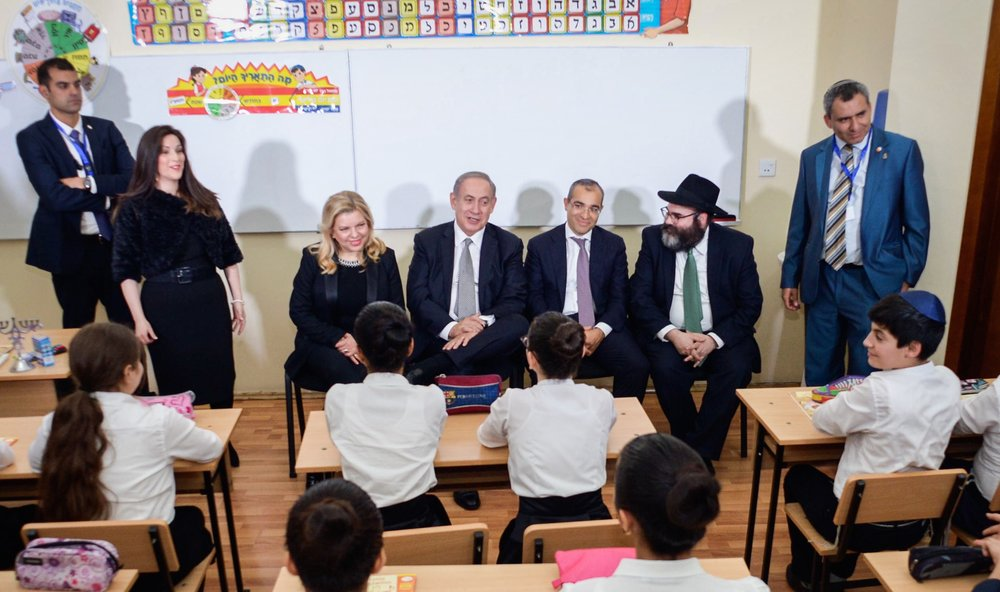 Israeli Prime Minister Benjamin Netanyahu and his wife Sara visit Jewish students and educators at the Chabad house in Baku, Azerbaijan, Dec. 13. Credit: Haim Zach/GPO.