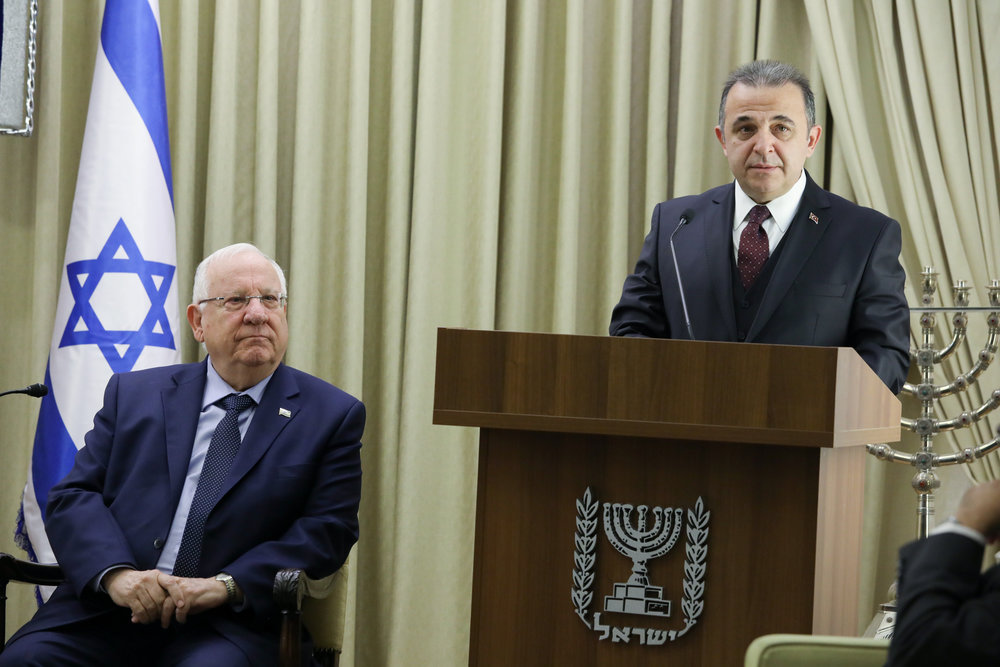 Israeli President Reuven Rivlin (left) looks on as incoming Turkish Ambassador to Israel Kemal Okem speaks during a ceremony for new ambassadors at the President's Residence in Jerusalem Dec. 12, 2016. Credit: Isaac Harari/Flash90.