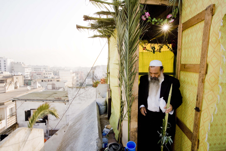 Rabbi Aharon Cohen, head of Casablanca's Jewish community, in a sukkah on the holiday of Sukkot in the Jewish quarter of the Old City of Casablanca, Oct. 6, 2009. Credit: Abir Sultan/Flash 90.