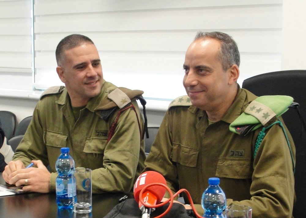 Training commander Major Kobi Assulin (left) and base commander Col. Avi Motola speak at the Israel Defense Forces City of Training Bases in the Negev. Credit: Judy Lash Balint.