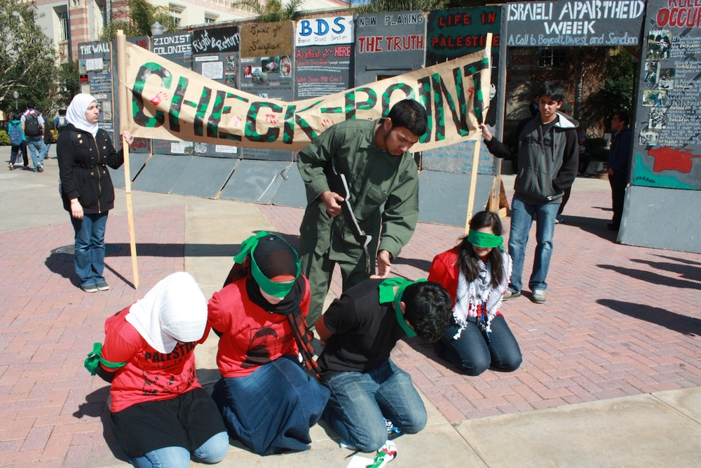 """A mock checkpoint that was set up during """"Israeli Apartheid Week,"""" an annual global anti-Israel initiative, in May 2010 on the University of California, Los Angeles campus. Credit: AMCHA Initiative."""