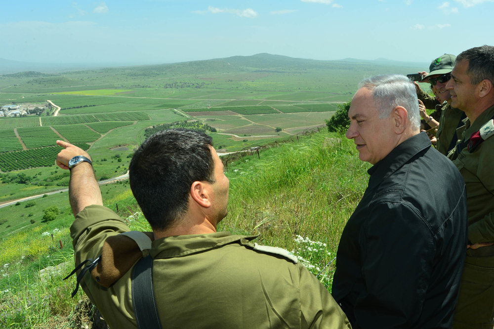 Israeli Prime Minister Benjamin Netanyahu (second from left) is pictured during a security and defense tour of the strategic Golan Heights region, near Israel's northern border with Syria, in April 2016. Credit: Kobi Gideon/GPO.