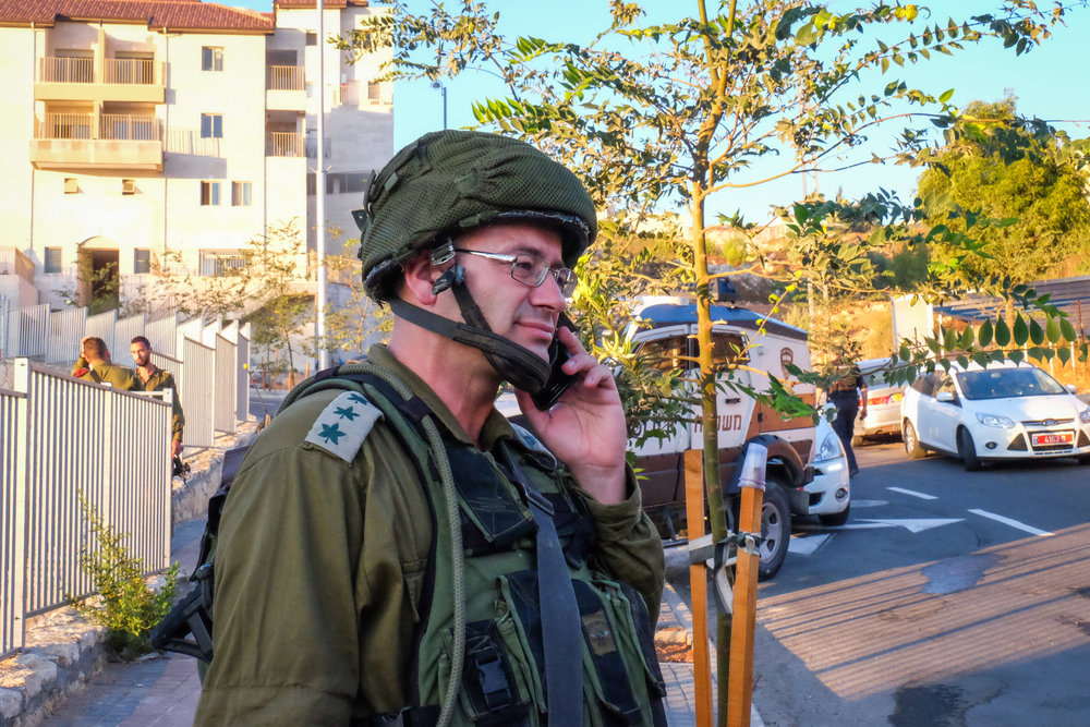 Israeli security forces at the scene where a Palestinian terrorist stabbed an Israel Defense Forces reserve officer in the Judea and Samaria community of Efrat, Sept. 18, 2016. Credit: Gerson Elinson/Flash90.