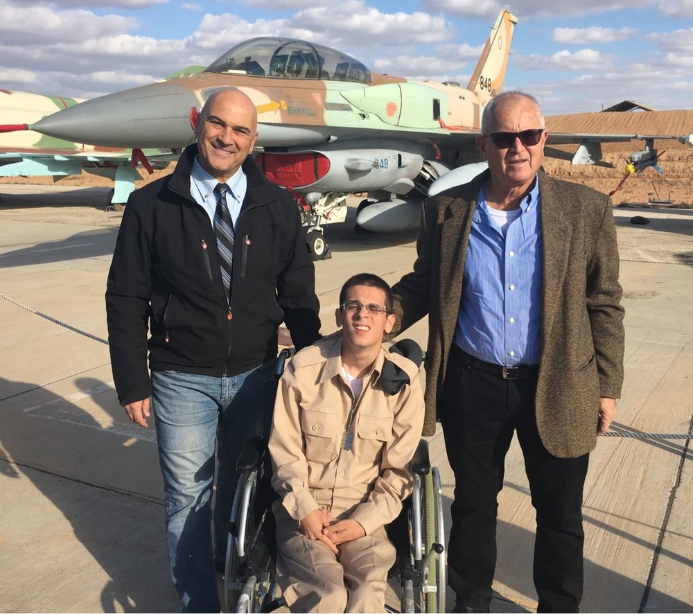 Omer Lahat (center), who has cerebral palsy and recently joined the Israel Defense Forces, is pictured at a Dec. 29 graduation ceremony for an Israeli Air Force pilots' course. Credit: Courtesy of Special in Uniform.