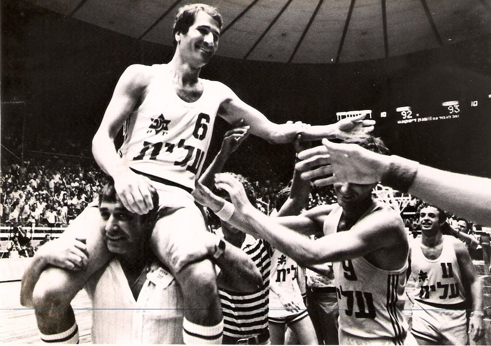 Maccabi Tel Aviv captain Tal Brody is lifted by his teammates following the Israeli basketball squad's upset victory over CSKA Moscow in 1977. Credit: On The Map.