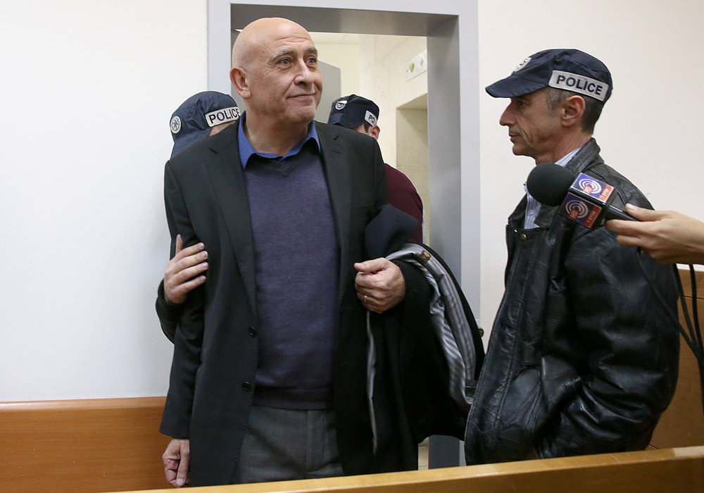 Basel Ghattas, an Arab member of the Israeli Knesset, is brought to the Rishon Lezion Magistrate's Court in central Israel Dec. 26, 2016, over allegations that he smuggled cell phones to Palestinian security prisoners. Credit: Koko/POOL/Flash90.