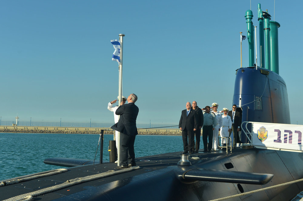 Prime Minister Benjamin Netanyahu helps raise the Israeli flag at a welcoming ceremony for Israel's new INS Rahav submarine at the Israeli Navy base in Haifa Jan. 12, 2016. Credit: Kobi Gideon/GPO.