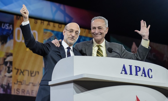 Senate Minority Leader Chuck Schumer (D-N.Y.)—pictured here, at right, on the stage of the 2014 AIPAC Policy Conference—supports a resolution condemning the recent United Nations Security Council resolution that called on Israel to halt settlement activity.