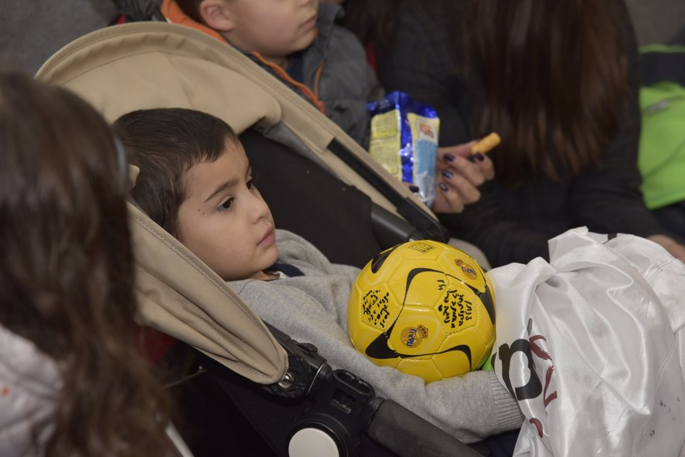 """Three-year-old Natan Bennett, who survived a Palestinian terror attack in October 2015, with a signed soccer ball at Thursday's ceremony in Jerusalem that marked his """"adoption"""" by the OneFamily soccer team. Credit: Sarah Levin, OneFamily."""