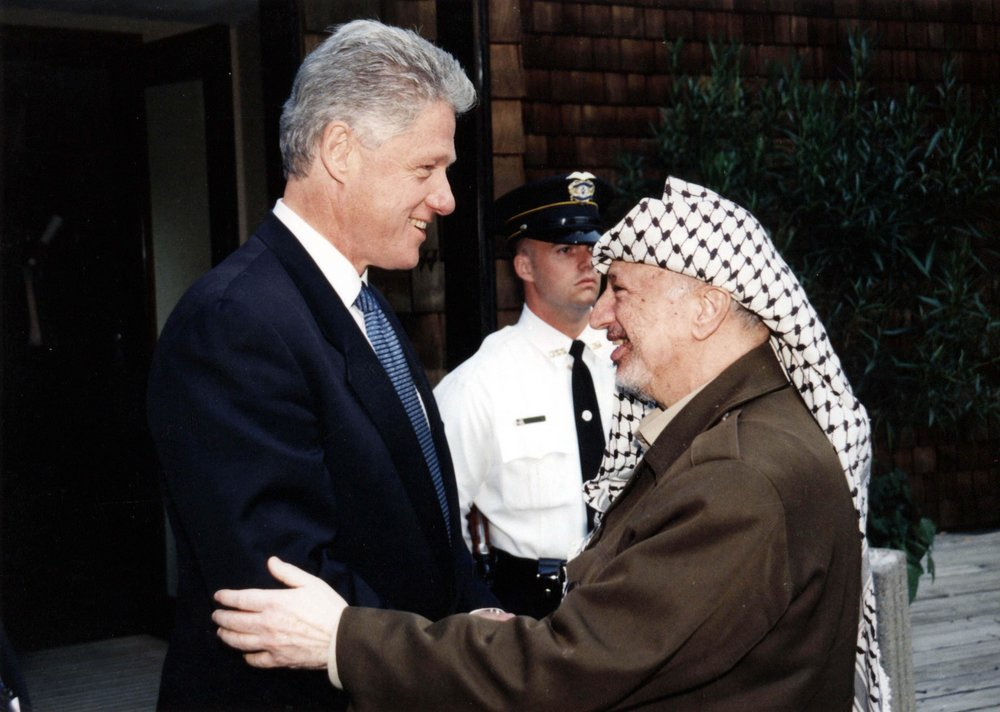 "Former U.S. President Bill Clinton (left) with former Palestinian leader Yasser Arafat. In this undated handout from the Palestinian Authorities is Yasser Arafat and Bill Clinton. Arafat rejected the December 2000 ""Clinton Parameters,"" a State Department-drafted peace plan that called for a Palestinian state in 95 percent of the disputed territories as well as Palestinian sovereignty over the Temple Mount and other parts of eastern Jerusalem. Credit: Abed Al Rahim Al Khatib/Flash90."