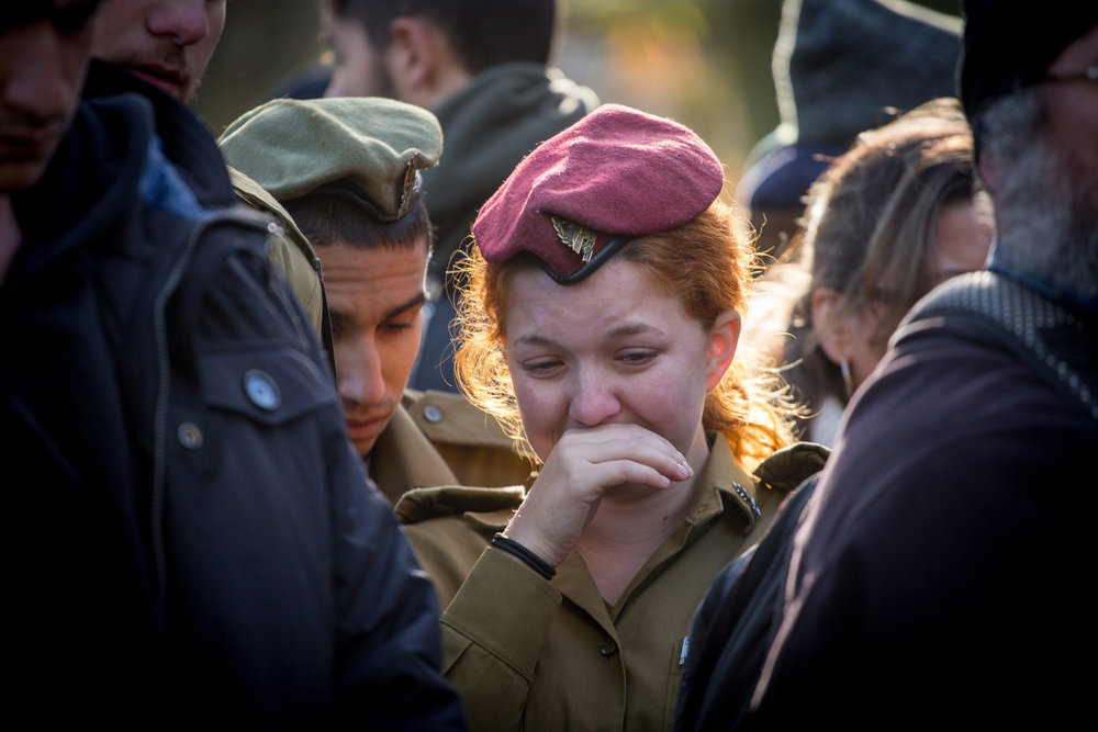 Family and friends mourn Shir Hajaj, one of the four Israeli soldiers killed in Sunday's truck-ramming terror attack, during her funeral at the Mount Herzl in Jerusalem Monday. Credit: Miriam Alster/Flash90.