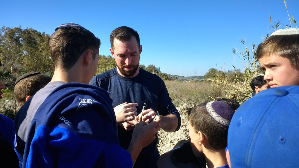Ike Davis, formerly of Major League Baseball's New York Mets, signs autographs for fans at the Jan. 6 groundbreaking for Israel's new Beit Shemesh Baseball Complex. Credit: Yocheved T. Kolchin.