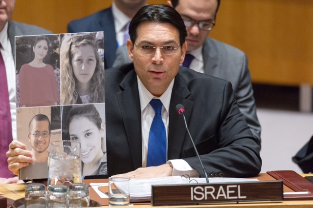 While addressing the United Nations Security Council Tuesday, Israeli Ambassador to the U.N. Danny Danon holds a photo of the four Israeli soldiers who were killed in this month's Palestinian truck-ramming terror attack in Jerusalem. Credit: Israeli Mission to the U.N.