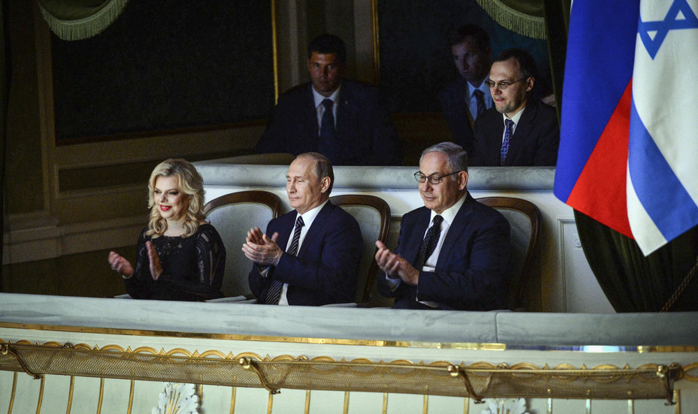 Israeli Prime Minister Benjamin Netanyahu (front right) and his wife Sara (left) with Russian President Vladimir Putin (center) at the Bolshoi Theatre in Moscow June 7, 2016. Credit: Haim Zach/GPO.