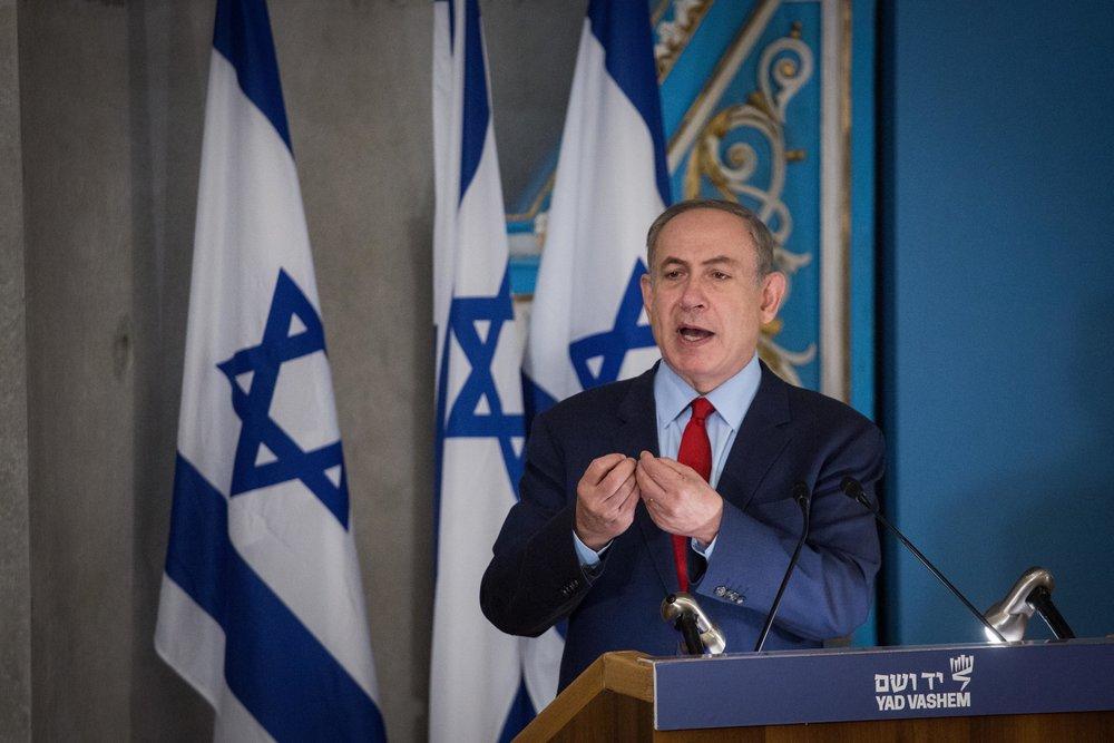 Israeli Prime Minister Benjamin Netanyahu speaks at the Yad Vashem Holocaust memorial in Jerusalem Jan. 26, the day before International Holocaust Remembrance Day. Credit: Hadas Parush/Flash90.