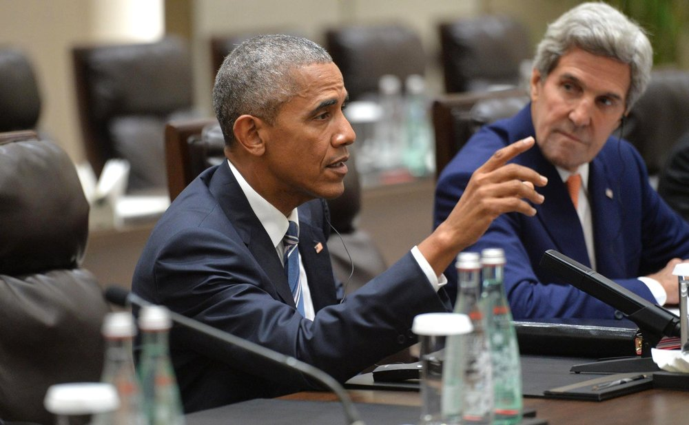 Former President Barack Obama (left) and former Secretary of State John Kerry. Credit: Kremlin.ru via Wikimedia Commons.
