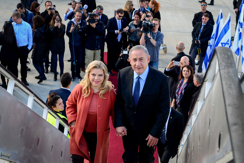 Israeli Prime Minister Benjamin Netanyahu and his wife Sara depart for their trip to the U.S. Feb. 13, 2017. Credit: Avi Ohayon/GPO.