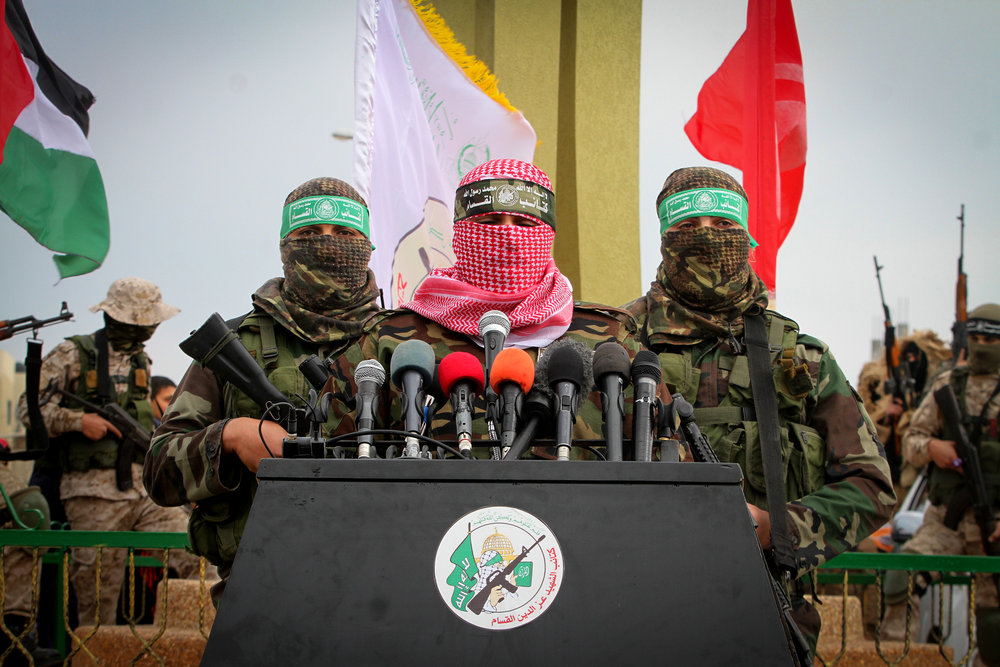 Abu Ubaida (in center), a spokesman for Hamas's military wing, speaks in the southern Gaza Strip town of Rafah Jan. 31, 2017. Credit: Abed Rahim Khatib/Flash90.